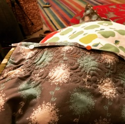 Stitching the binding - see the wrinkly back